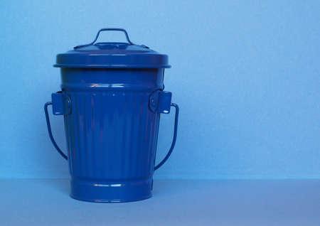 blue litter bin aka garbage or trash bin or waste bin with copy space Stok Fotoğraf