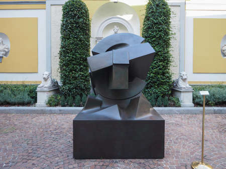 TURIN, ITALY - CIRCA AUGUST 2017: Stone sculpture entitled Sole Deposto (meaning Deposed Sun) by artist Gio Pomodoro outside Accorsi Ometto museum