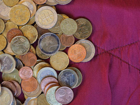 Euro coins money (EUR), currency of European Union over crimson red velvet background Stock fotó