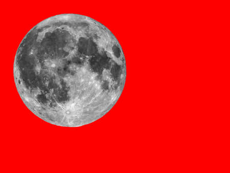Full moon seen with an astronomical telescope over red background with copy space Stock Photo