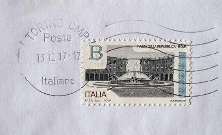 TURIN, ITALY - CIRCA DECEMBER 2017: a class B stamp printed by Italy showing Piazza della Repubblica square in Rome