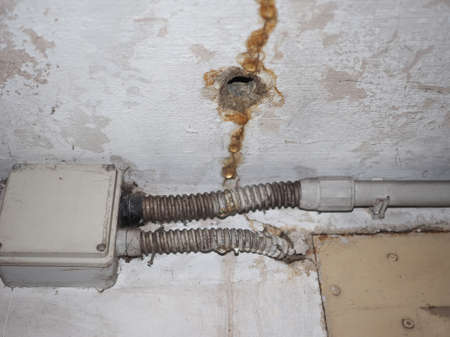 damage caused by dampness and moisture on a wall Stock Photo