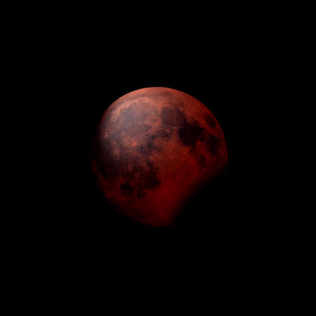 Red moon during a partial lunar eclipse Stock Photo