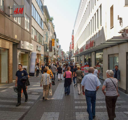 KOELN, GERMANY - CIRCA AUGUST 2009: People in the city centre