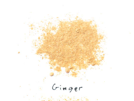 Ginger root (Zingiber officinale) powder Indian spice over white background