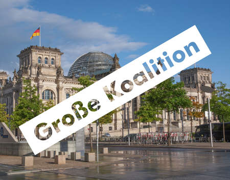 Grosse Koalition (meaning Grand Coalition) superimposed to the Reichstag houses of parliament in Berlin, Germany