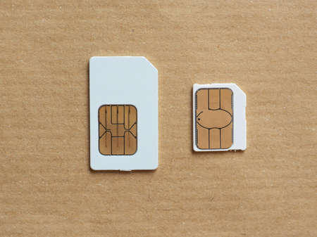 SIM and USIM cards used in mobile telephony devices such as phones and smart phones Stock Photo