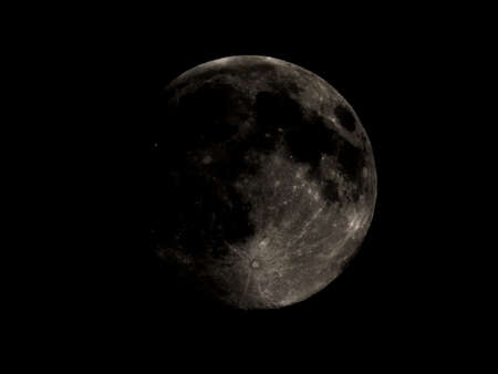 High contrast Full moon seen with an astronomical telescope Stock Photo