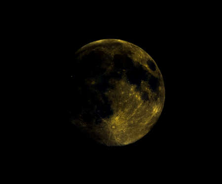 High contrast Full moon seen with an astronomical telescope, with heavily enhanced colours to show the real colours of terrain surface