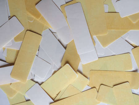 blank white and yellow adhesive labels for tagging