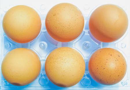 Half dozen eggs in a plastic carton box Imagens
