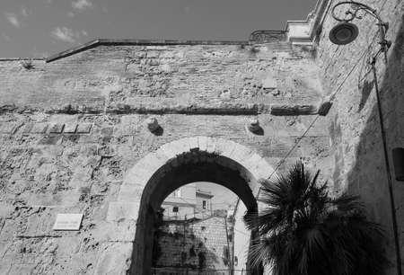 Porta dei Due Leoni (meaning Two Lions Gate) in Castello quarter in Cagliari, Italy in black and white