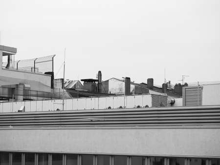 urban skyline with roof chimneys and air conditioning units and aerials in black and white