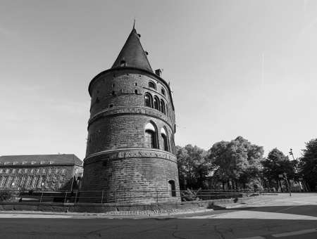 Holstentor (previously Holstein Tor, meaning Holsten Gate) in Luebeck, Germany in black and white 写真素材