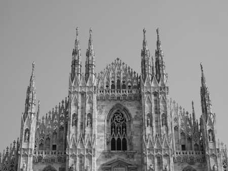Duomo di Milano (meaning Milan Cathedral) church in Milan, Italy in black and white