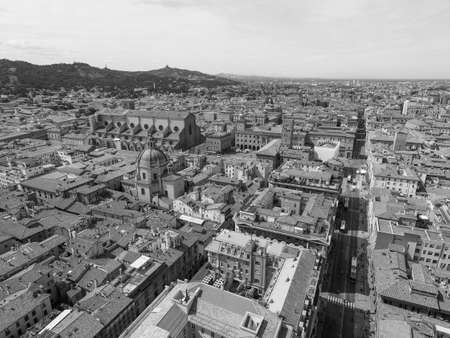 Aerial view of Via dell Indipendenza street and Piazza Maggiore square in the city of Bologna, Italy in black and white 写真素材