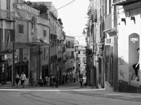 CAGLIARI, ITALY - CIRCA SEPTEMBER 2017: People in Castello quarter aka Casteddu e susu (meaning Upper Castle in Sard) old medieval town city centre in black and white