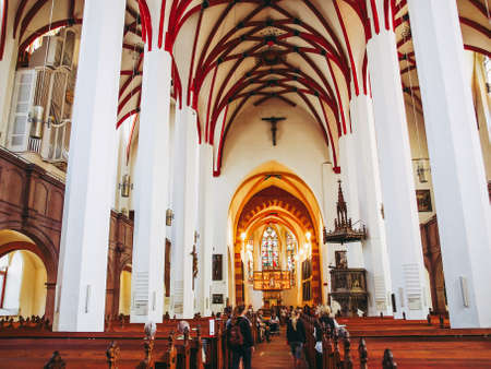 LEIPZIG, GERMANY - JUNE 12, 2014: People visiting the Thomaskirche St Thomas Church where Johann Sebastian Bach worked as a Kapellmeister and the current location of his remains