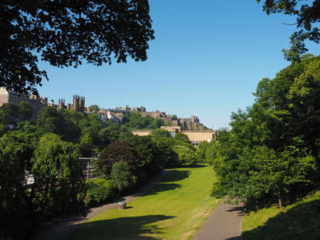 EDINBURGH, UK - CIRCA JUNE 2018: Castle seen from the Mound, artificial hill connecting the new and old town