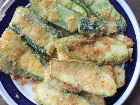 breaded courgettes (Cucurbita pepo) aka zucchini vegetables vegetarian and vegan food