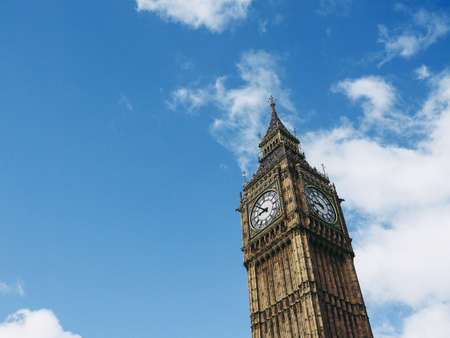 Big Ben at the Houses of Parliament aka Westminster Palace in London, UK - blue sky