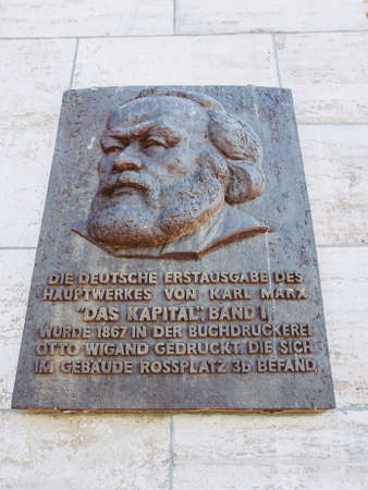 LEIPZIG, GERMANY - JUNE 12, 2014: Commemorative plaque for the printing of the first edition of Karl Marx Das Kapital Capital in 1867 in Leipzig