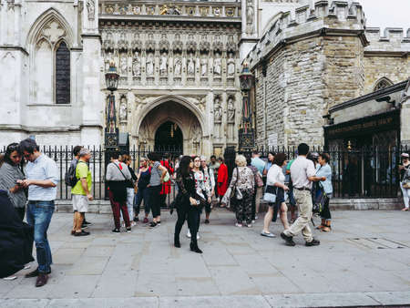 LONDON, UK - CIRCA JUNE 2018: People leaving the Evensong choral service at Westminster Abbey anglican church Editorial