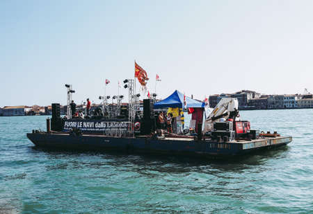 VENICE, ITALY - CIRCA SEPTEMBER 2016: Fuori le navi dalla laguna (meaning No cruise ships in the lagoon) protest with many guests including Italian musician Eugenio Finardi