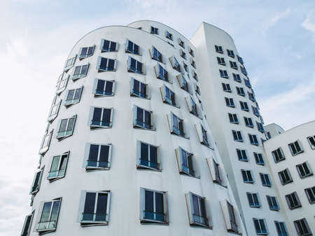 DUESSELDORF, GERMANY - AUGUST 3, 2009: The new Medienafen is a redevelopment area in the former docklands and harbour with buildings designed by Steven Holl, David Chipperfield and Frank O Gehry Editorial