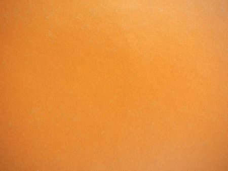 Orange paper texture useful as a background, soft pastel colour 免版税图像