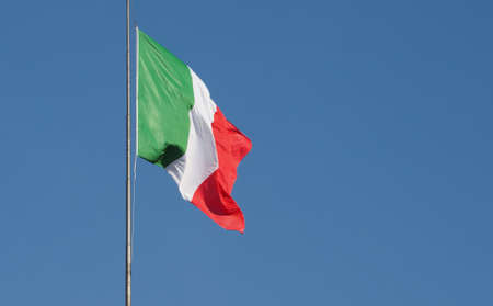 Flag of Italy, Europe over blue sky