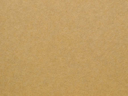 Sheet of brown paper useful as a background, soft pastel colour
