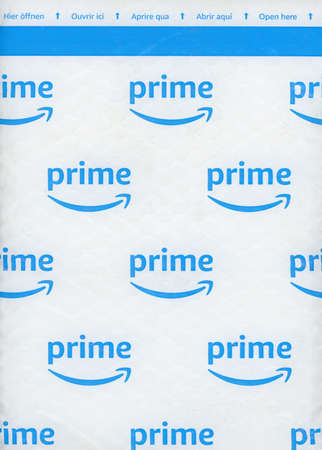 SEATTLE, USA - CIRCA DECEMBER 2018: Amazon Prime logo on a packet. Members of Prime receive benefits which include free fast shipping for eligible purchases, streaming of movies, TV shows and music