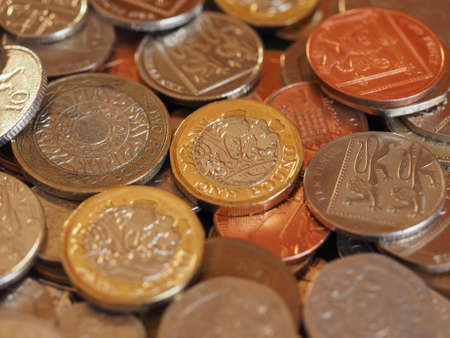 Pound coins money (GBP), currency of United Kingdom useful as a background