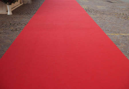 blank red carpet on to mark the route of heads of state, vips and celebrities on ceremonial and formal occasions or events 写真素材