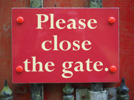 please close the gate sign on a door