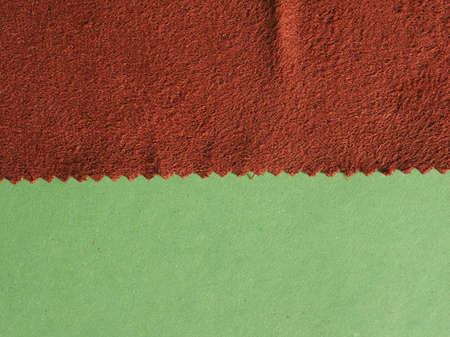 brown fabric swatch sample with zig zag border cut with pinking shears Reklamní fotografie