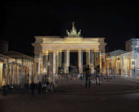 BERLIN, GERMANY - CIRCA JUNE 2016: Kaleidoscopic psychedelic double exposure of tourists at Brandenburger Tor (meaning Brandenburg Gate) at night