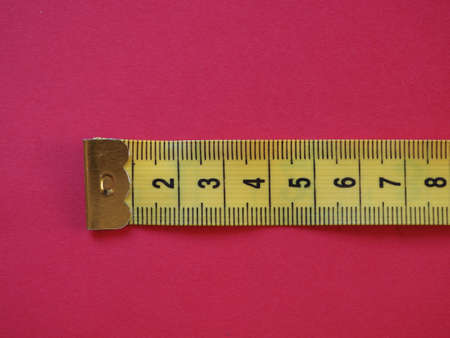 a ruler with metric units, over red background