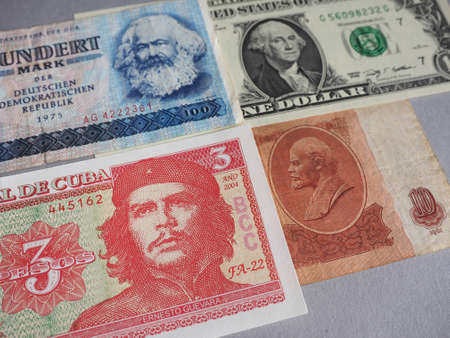 Portraits of Marx, Washington, Che Guevara and Lenin on DDR, USA, Cuba and CCCP banknotes