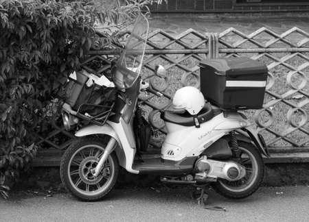 TURIN, ITALY - CIRCA SEPTEMBER 2018: Poste Italiane mail delivery motor bike in black and white Editoriali