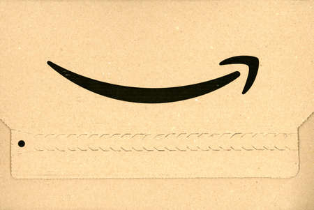 SEATTLE, USA - CIRCA MARCH 2019: Amazon logo on a parcel Redactioneel