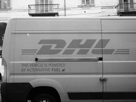 TURIN, ITALY - CIRCA NOVEMBER 2018: DHL courier van in black and white