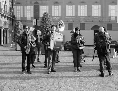 TURIN, ITALY - CIRCA DECEMBER 2018: Banda del Roero marching band in black and white Banco de Imagens - 119112979
