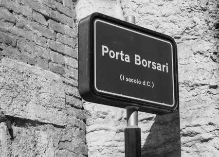 Porta Borsari (aka Porta Iovia) city gate sign in Verona, Italy in black and white