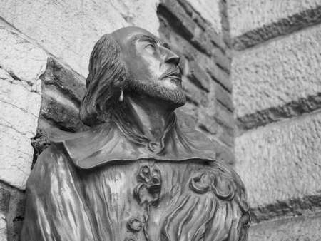 VERONA, ITALY - CIRCA MARCH 2019: William Shakespeare bronze bust statue in Verona, the city of Romeo and Juliet in black and white