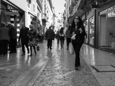 VERONA, ITALY - CIRCA MARCH 2019: People in the city centre in black and white