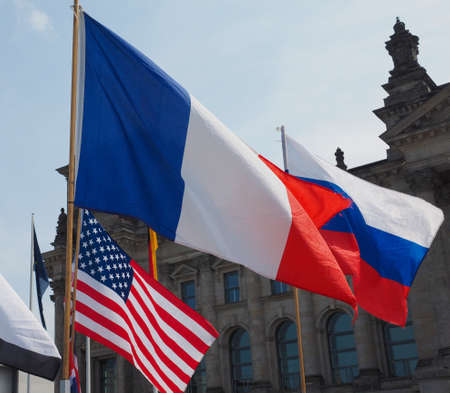 French, Russian and American flags in front of German Bundestag parliament