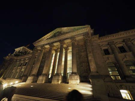 Bundestag German Houses of Parliament in Berlin, Germany at night. Dem deutschen Volke means To the German people