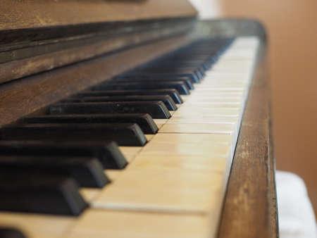 detail of piano keyboard keys on vintage instrument Фото со стока